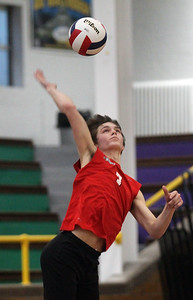 Candace H. Johnson-For Shaw Media Grant's Derek Kolb serves against Waukegan in the second set during the season opener at Waukegan High School. Waukegan won 25-15, 25-11. (3/19/19)