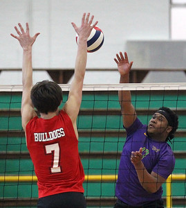 Candace H. Johnson-For Shaw Media Grant's Derek Kolb puts up a block against Waukegan's Jerrel McMillon in the first set during the season opener at Waukegan High School. Waukegan won 25-15, 25-11. (3/19/19)