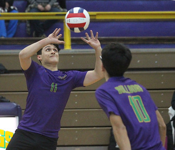 Candace H. Johnson-For Shaw Media Waukegan's Kenneth Hernandez sets the ball to Diego Diaz against Grant in the second set during the season opener at Waukegan High School. Waukegan won 25-15, 25-11. (3/19/19)
