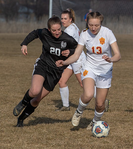 Woodstock North's Trinity Tillman (Left) goes for the steal against Richmond-Burton's Leigha Denzel Thursday, March 21, 2019 in Woodstock. Woodstock North went on to win 5-0.  KKoontz – For Shaw Media