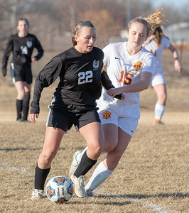 Woodstock North's Taylor Prerost (left) battles against Richmond-Burton's Darci Retherford Thursday, March 21, 2019 in Woodstock. Prerost went on to score four goals as Woodstock North went on to win 5-0.  KKoontz – For Shaw Media