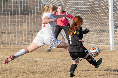Woodstock North's Anastasia Mazzanti takes a shot on goal past Richmond Burton defender Audrey Orklid Thursday, March 21, 2019 in Woodstock. Woodstock went onto win the Kishwaukee River Conference match-up 5-0. KKoontz – For Shaw Media