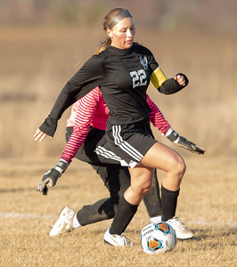 Woodstock North's Taylor Prerost works for position against Richmond-Burton Thursday, March 21, 2019 in Woodstock. Prerost went on to score four goals as Woodstock North went on to win 5-0.  KKoontz – For Shaw Media