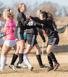 Woodstock North teammates Taylor Prerost and Bianca Cruz celebrate a goal against Richmond-Burton Thursday, March 21, 2019 in Woodstock. On the play, Cruz took a shot and Prerost put the deflected ball into the goal. Woodstock North went onto win the Kishwaukee River Conference match 5-0. KKoontz – For Shaw Media