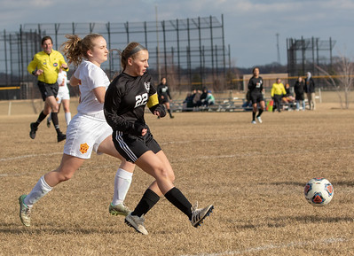 Woodstock North's Taylor Prerost passes the ball to a teammate against Richmond-Burton Thursday, March 21, 2019 in Woodstock. Prerost went on to score four goals as Woodstock North went on to win 5-0.  KKoontz – For Shaw Media