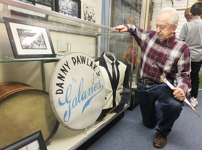 Candace H. Johnson-For Shaw Media Dan (Danny) Pawlak, Jr., of Ingleside looks at his bass drum head used when he was a drummer with the Bill Hoff & The Galaxies band which played from 1958-1974 around the area on display at the Grant Hall Museum on Washington Street in Ingleside. Pawlak is a member of the Fox Lake-Grant Township Area Historical Society which runs the museum and was at the museum as a volunteer to answer questions from Stanton School 5th graders on a field trip.(3/18/19)