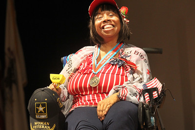 """Candace H. Johnson-For Shaw Media Army veteran Babette Peyton, of Chicago dances in her wheelchair to the song, """"Here's to the Red, White and Blue,"""" during the Veterans Creative Arts Festival at the College of Lake County in Grayslake. (3/14/19)"""