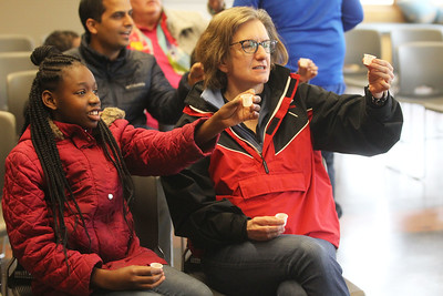 "Candace H. Johnson-For Shaw Media Ja'mara Northington, 11, of Waukegan and Kathryn Hayley, of Lincolnshire say, ""cheers,"" to the sugar maple tree as they drink its sap and sap turned into maple syrup during a presentation before taking a maple syrup hike at Ryerson Woods in Riverwoods. Ryerson Woods is part of the Lake County Forest Preserves. (3/24/19)"