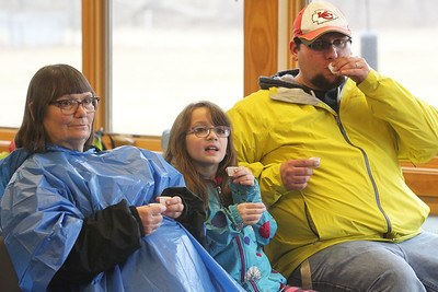 Candace H. Johnson-For Shaw Media Jon DeRisi, of Wonder Lake (on right) tries some sap and sap made into maple syrup with his daughter, Abigail, 8, and mother, Mary DeRisi, of Wichita, Kan., as they listen to a presentation before going out on a maple syrup hike at Ryerson Woods in Riverwoods. Ryerson Woods is part of the Lake County Forest Preserves. (3/24/19)