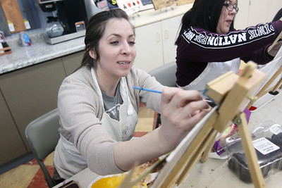 Candace H. Johnson-For Shaw Media Stephanie Pirrello, of Lake Villa sits next to Vanessa Rosans, of Waukegan as they work on their wine glasses paintings during a Paint & Sip art class at Studio 25 Art Creations art studio on Nippersink Blvd. in Fox Lake. (3/22/19)