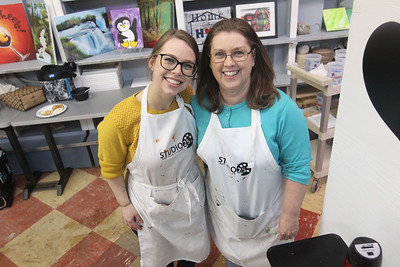 Candace H. Johnson-For Shaw Media Amanda Munsen, of Ingleside gets help from her mother, Cindy, as she teaches a Paint & Sip art class at Studio 25 Art Creations on Nippersink Blvd. in Fox Lake. (3/22/19)