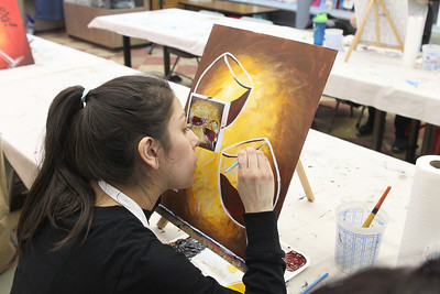 Candace H. Johnson-For Shaw Media Natalie Chapa, of McHenry works on making a wine glasses painting while using a picture for reference during a Paint & Sip art class at Studio 25 Art Creations on Nippersink Blvd. in Fox Lake. (3/22/19)