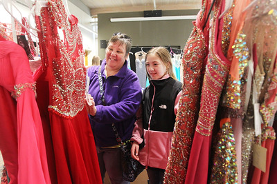 Candace H. Johnson-For Shaw Media Judy Evans helps her niece, Hannah Beetham, 12, both of Island Lake pick out a dress at the Prom Shoppe in the Wauconda Area Library. (3/23/19)