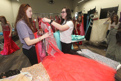 Candace H. Johnson-For Shaw Media Shannon McNutt and Morgan Bilancia both 17, of Island Lake look at prom dresses together at the Prom Shoppe in the Wauconda Area Library. (3/23/19)