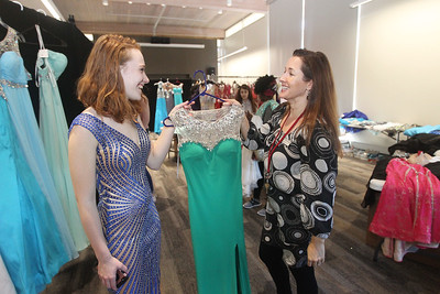 Candace H. Johnson-For Shaw Media Hallie Fedorowicz, 17, of Island Lake gets some help from Patty Gmitrovic, of Island Lake, program coordinator, picking out a dress for her prom at the Prom Shoppe in the Wauconda Area Library. (3/23/19)