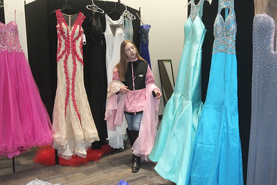 Candace H. Johnson-For Shaw Media Hannah Beetham, 12, of Island Lake looks at some of the free beautiful dresses to choose from at the Prom Shoppe in the Wauconda Area Library. (3/23/19)