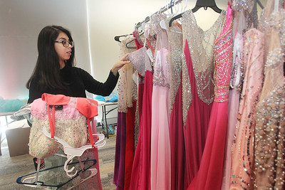 Candace H. Johnson-For Shaw Media Lesly Lobo, 17, of Wauconda picks out prom dresses to try on at the Prom Shoppe in the Wauconda Area Library. (3/23/19)