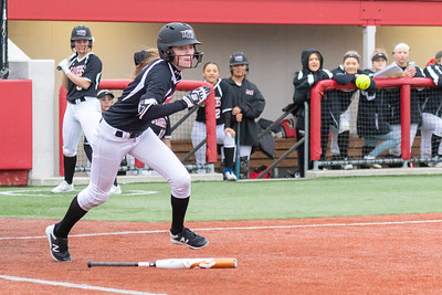 Huntley High School sophomore Marley Reicher lays down a bunt against DeKalb Thursday, March 28, 2019 at the Chicago Bandits Stadium in Rosemont. Huntley gets the win with a 4-0 shutout.  KKoontz – For Shaw Media