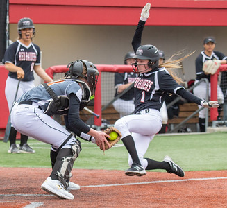 Huntley High School sophomore Marley Reicher is tagged out at home by DeKalb catcher Emma Friedlund Thursday, March 28, 2019 at the Chicago Bandits Stadium in Rosemont. Huntley gets the win with a 4-0 shutout.  KKoontz – For Shaw Media