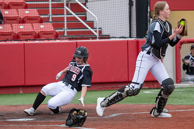Huntley High School sophomore Abigail Simandl slides into home against DeKalb Thursday, March 28, 2019 at the Chicago Bandits Stadium in Rosemont. Huntley gets the win with a 4-0 shutout.  KKoontz – For Shaw Media