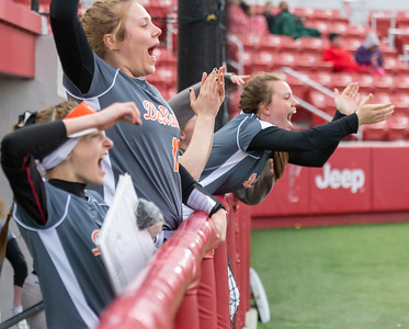 The DeKalb bench erupts in cheers after their first hit against Huntley Thursday, March 28, 2019 at Chicago Bandits Stadium in Rosemont. DeKalb came up short with Huntley taking the non-conference win 4-0. KKoontz – For Shaw Media
