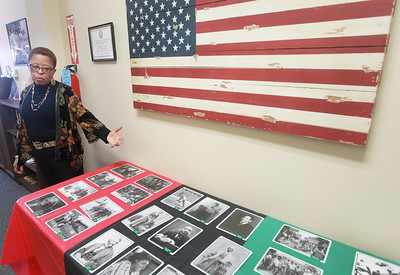 Candace H. Johnson-For Shaw Media Dr. Mary Roberson, social services supervisor and Navy veteran, talks about the photos on display of prominent African Americans throughout history after the 4th Annual Chat N' Chew to honor African American Vets and Families during Black History Month at the Lake County Veterans and Family Services Foundation in Grayslake. (2/26/20)
