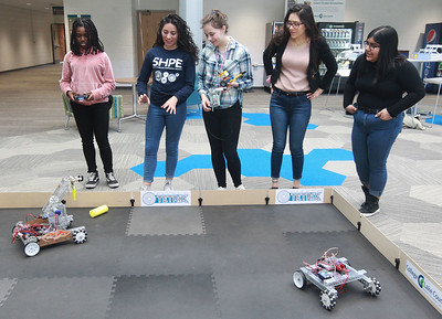 """Candace H. Johnson-For Shaw Media A group of girls line up to check out robots which need controllers to move in the workshop called, """"Robots, Robots, Everywhere,"""" during the 10th Annual STEM for Girls at the College of Lake County in Grayslake. (2/29/20)"""
