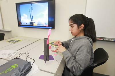 """Candace H. Johnson-For Shaw Media Arushi Srinivasan, 13, of Lincolnshire works on making a foam rocket in the """"Want to Fly? Rockets, NASA and Creativity,"""" workshop during the 10th Annual STEM for Girls at the College of Lake County in Grayslake. (2/29/20)"""