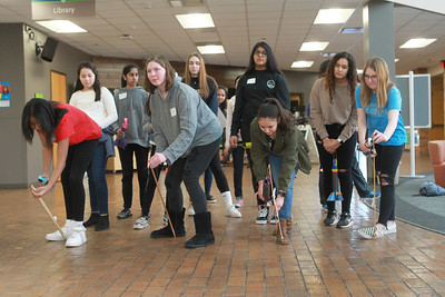 """Candace H. Johnson-For Shaw Media A group of girls stand in line to launch the foam rockets that they made during the workshop called, """"Want to Fly? Rockets, NASA and Creativity,"""" during the 10th Annual STEM for Girls at the College of Lake County in Grayslake. (2/29/20)"""