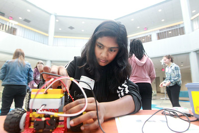 """Candace H. Johnson-For Shaw Media Isabella Isaac, 12, Gurnee builds a 2-wheeled robot car in the workshop called, """"Robots, Robots, Everywhere,"""" during the 10th Annual STEM for Girls at the College of Lake County in Grayslake. (2/29/20)"""