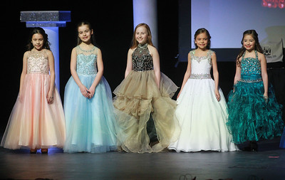 Candace H. Johnson-For Shaw Media Little Miss Lake County contestants stand on stage in their formal wear for an ensemble review during the 2020 Lake County Illinois State Pageant at Antioch Community High School. There were ten contestants competing for the title of Little Miss. (2/29/20)