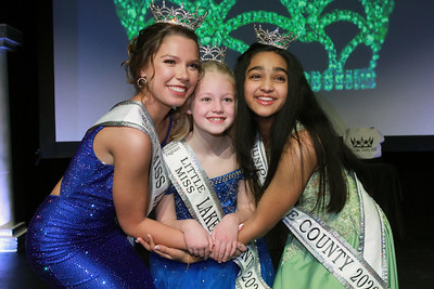 Candace H. Johnson-For Shaw Media Lauren Allen, 19, of Gurnee, Kinsie Gifford, 8, of Libertyville and Rachel Varghese, 12, of Long Grove pose for a picture after being crown the new 2020 Lake County Illinois queens as Miss, Little Miss and Junior Miss during the 2020 Lake County Illinois State Pageant at Antioch Community High School. (2/29/20)