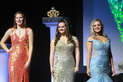 Candace H. Johnson-For Shaw Media Lyrik Stay, Miss Antioch, Sydney Schmidt, Miss Lindenhurst and Celeste Cortes, Miss Mundelein stand on stage in their formal wear for the ensemble review as they compete to become the 2020 Miss Lake County during the 2020 Lake County Illinois State Pageant at Antioch Community High School. (2/29/20)