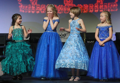 Candace H. Johnson-For Shaw Media Kinsie Gifford, 8, Little Miss Lake County Area of Libertyville (second from left) reacts after just learning she had won the title of Little Miss Lake County as she stands next to contestants, Vivian Camp, Claire Milne and Taylor Gergely during the 2020 Lake County Illinois State Pageant at Antioch Community High School. (2/29/20)