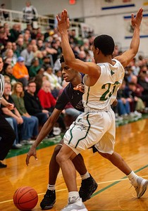 Hampshire's Collin Woods tries to get past Boylan's Dayvion Foreman during the second quarter of the Class 3A Boylan Sectional semifinal game in Rockford on Wednesday, Mar. 11, 2020. Randy Stukenberg for Shaw Media.
