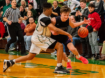 Hampshire's Jackson Milison drives past Boylan's Anthony Brown during the fourth quarter of the Class 3A Boylan Sectional semifinal game in Rockford on Wednesday, Mar. 11, 2020. Randy Stukenberg for Shaw Media.