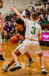 Hampshire's Jeremy Rosa, Jr., pushes into Boylan's Johnny Close during the first quarter of the Class 3A Boylan Sectional semifinal game in Rockford on Wednesday, Mar. 11, 2020. Randy Stukenberg for Shaw Media.