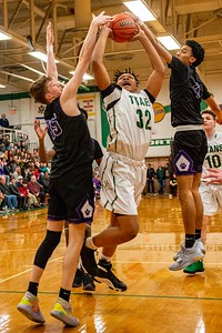 Hampshire's Nicholas Erickson, left, and Jeremy Rosa, Jr., block a shot by Boylan's Anthony Brown during the third quarter of the Class 3A Boylan Sectional semifinal game in Rockford on Wednesday, Mar. 11, 2020. Randy Stukenberg for Shaw Media.