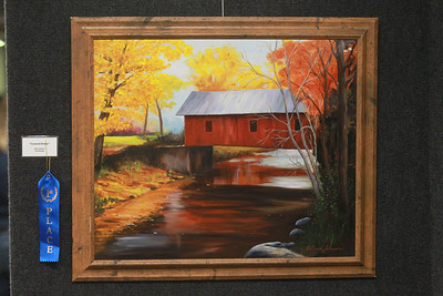 """Candace H. Johnson-For Shaw Media An oil painting titled, """"Covered Bridge,"""" by Allen Johnson was on display during the annual Veterans Creative Arts Festival at the College of Lake County in Grayslake. The arts festival was presented by the Captain James A. Lovell Federal Health Care Center. (3/5/20)"""