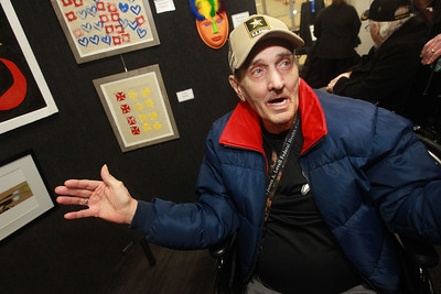 """Candace H. Johnson-For Shaw Media Ralph Barzowski, of North Chicago, a Vietnam Army veteran, talks about the acrylic painting he made in a recreational therapy class titled, """"Sunburst,"""" during the annual Veterans Creative Arts Festival at the College of Lake County in Grayslake. The arts festival was presented by the Captain James A. Lovell Federal Health Care Center. (3/5/20)"""