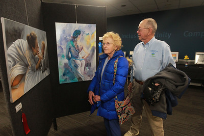 Candace H. Johnson-For Shaw Media Ginny and John Dereu, of Libertyville look at paintings by Jerry Zabel during the annual Veterans Creative Arts Festival at the College of Lake County in Grayslake. John Dereu served in the Army for twenty years. The arts festival was presented by the Captain James A. Lovell Federal Health Care Center. (3/5/20)