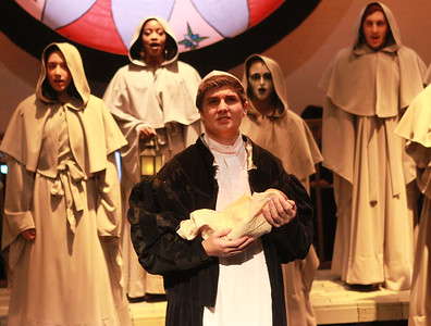 "Candace H. Johnson-For Shaw Media Dom Claude Frollo (Aaron Stone) and the ensemble sing, ""The Bells of Notre Dame,"" during the Green Room Theatre Company's Hunchback of Notre Dame at Grayslake North High School. Cheryl Schwartz is the director of the musical. The show will run on March 12, 13, and 14th, at 7:00 pm. and March 15th, at 2 pm. (3/7/20)"