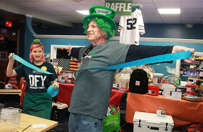 Candace H. Johnson-For Shaw Media Ashlee Otis, 18, of Salem, Wis., measures an arm's length of raffle tickets on Jim Goblirsch, of Lake Villa during the 10th Annual Kristof's Cares for Kids Rock the Bald St. Baldrick's event in Round Lake Beach. (3/7/20)