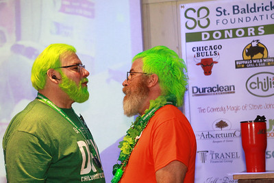 Candace H. Johnson-For Shaw Media Tom Welninksi, of Antioch and Mike Schmieg, of Volo, co-organizers, share the stage during the 10th Annual Kristof's Cares for Kids Rock the Bald St. Baldrick's Event in Round Lake Beach. The event raised over $15,000 .(3/7/20)