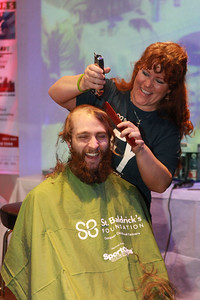 Candace H. Johnson-For Shaw Media Jacob Kleinhardt, of Waukegan shares a laugh with Amanda Rogers, of McHenry, an independent hair stylist, as she shaves his hair off during the 10th Annual Kristof's Cares for Kids Rock the Bald St. Baldrick's event in Round Lake Beach. (3/7/20)
