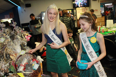 Candace H. Johnson-For Shaw Media Keira Dasnis, 15, of Volo and Kailee Albeck, 9, of Round Lake, both Round Lake Area queens, check out the raffle ticket items during the 10th Annual Kristof's Cares for Kids Rock the Bald St. Baldrick's event in Round Lake Beach. (3/7/20)