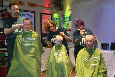 Candace H. Johnson-For Shaw Media Eric Nowinski, of Spring Grove, his son Logan, 3, and grandfather, Andrew, of Round Lake Beach get their hair shaved by Kevin Slimko, of Crystal Lake, Wendi Hutchings, of Wauconda and Shannon Donnelly of Ingleside during the 10th Annual Kristof's Cares for Kids Rock the Bald St. Baldrick's Event in Round Lake Beach. All three were getting their heads shaved for Logan's little brother, Teddy, nine-months-old, who has neuroblastoma. (3/7/20)