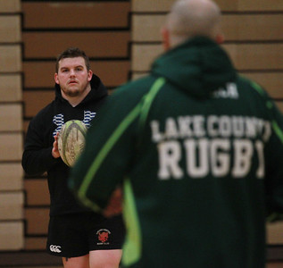Candace H. Johnson-For Shaw Media Blake Parsons, of Lake Villa listens to Mike Bruce, of Grayslake, head coach, during a Lake County Rugby Club's practice at Carmel Catholic High School in Mundelein. (2/27/20)