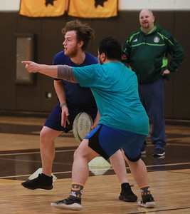 Candace H. Johnson-For Shaw Media Max Lynn, of Woodstock and Juan Soto, of Antioch work on a passing drill during the Lake County Rugby Club's practice at Carmel Catholic High School in Mundelein. (2/27/20)