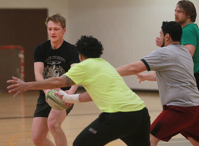 Candace H. Johnson-For Shaw Media Daniel Bazan, of Mundelein makes a pass during a Lake County Rugby Club's practice at Carmel Catholic High School in Mundelein. (2/27/20)